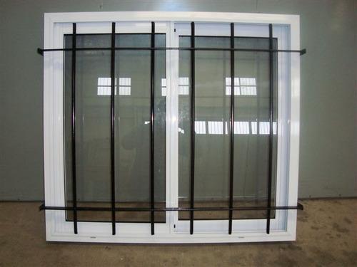 Ventana aluminio blanco con vidrio y reja 100x90 for Ventanas de aluminio doble vidrio argentina