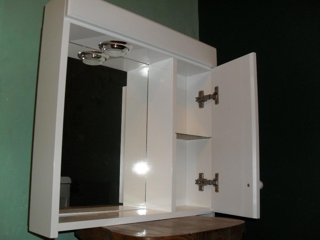 Mueble para bano con espejo y luz for Espejos ovalados de pared