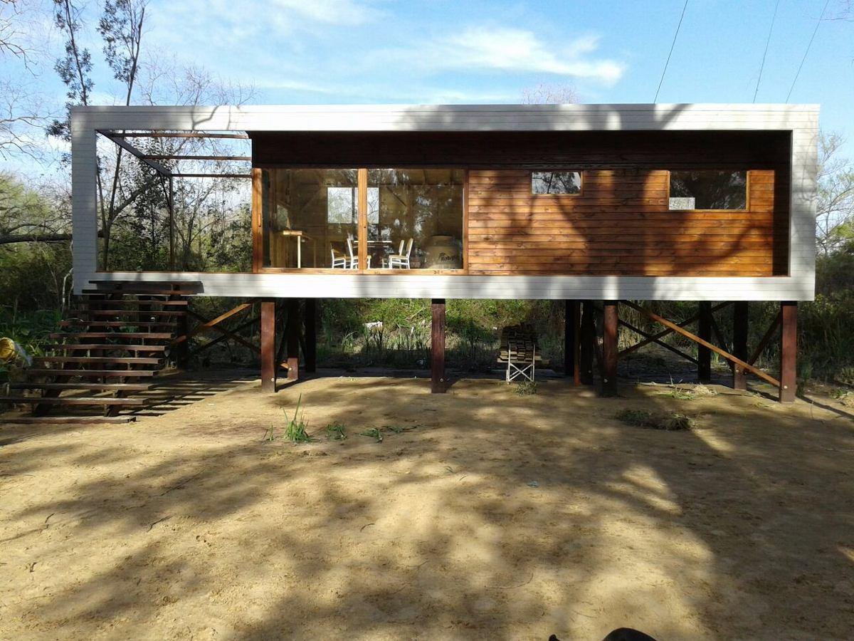 Construcci n caba as casas de madera deck muelles - Precio construccion casa ...