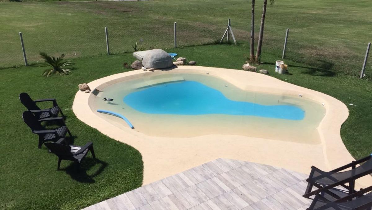 Construcci n de piscinas playas arena pilar en mercado - Precio piscinas de arena ...