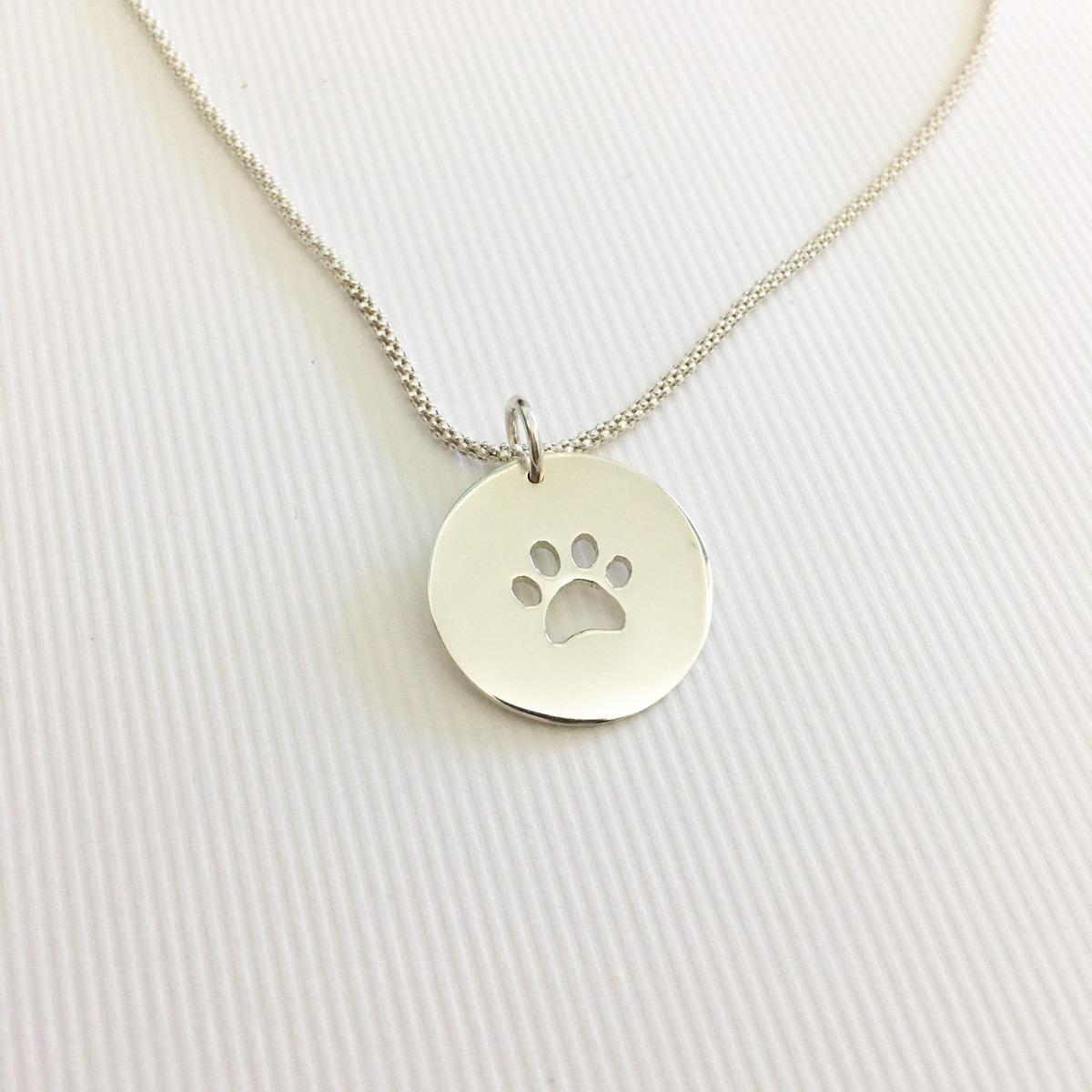 Medalla con patita de perro