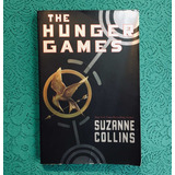 Suzanne Collins. THE HUNGER GAMES.